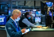 Dow futures little changed to kick off week amid rising coronavirus cases